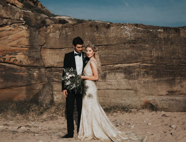 Beach wedding north east bride and groom by the rocks
