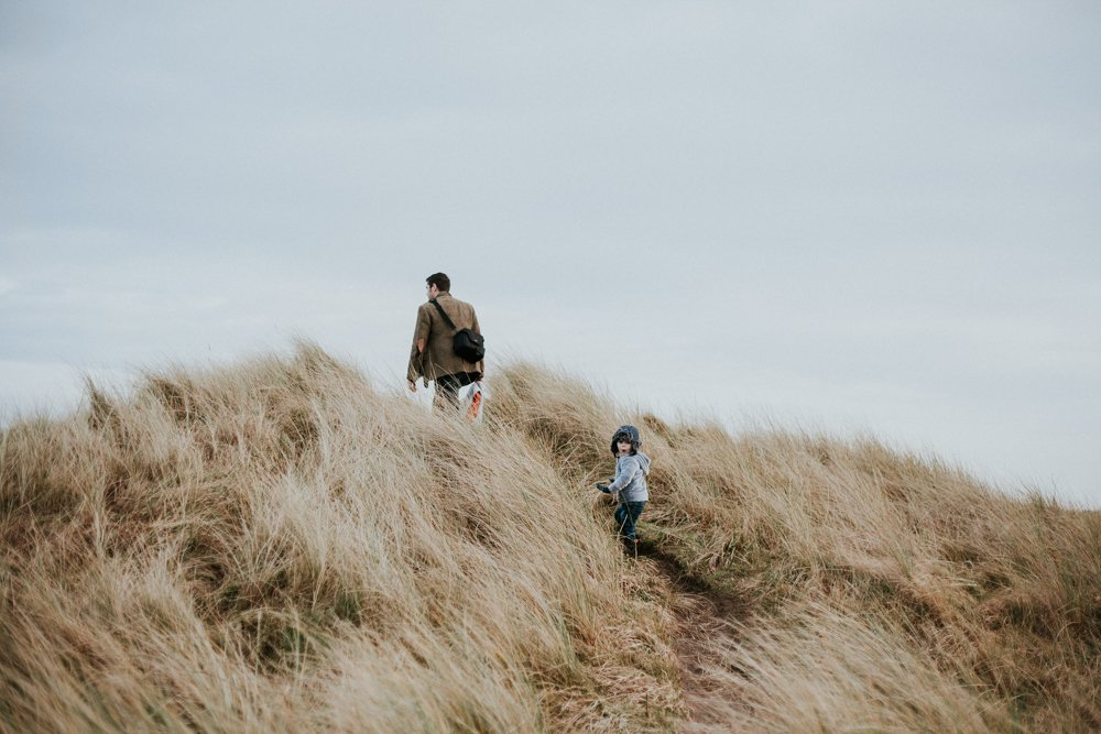 Father and Son walking though Amble Beach at family photo Session