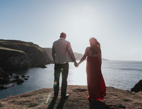 Couple holding hands on top of mountain at elopement session - wedding photographer north east