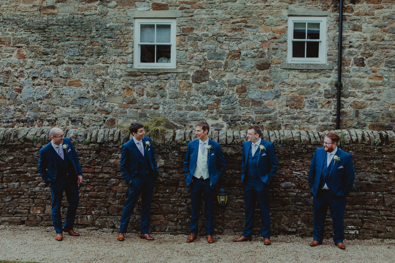 Healey Barn Wedding - Groom and groomsmen portrait at the lord crewe arms blanchland