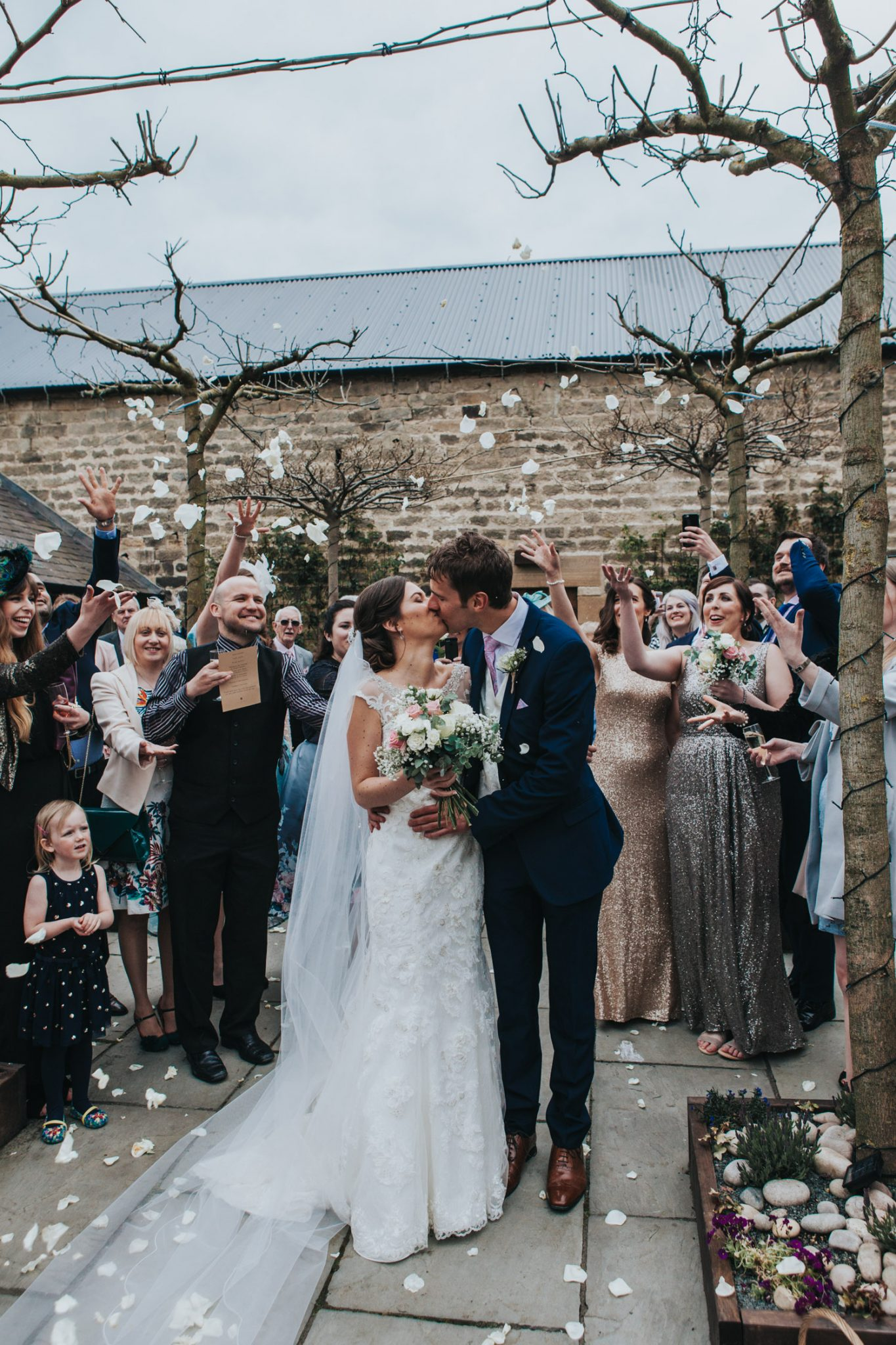 Healey Barn Wedding - bride and groom showered in confetti