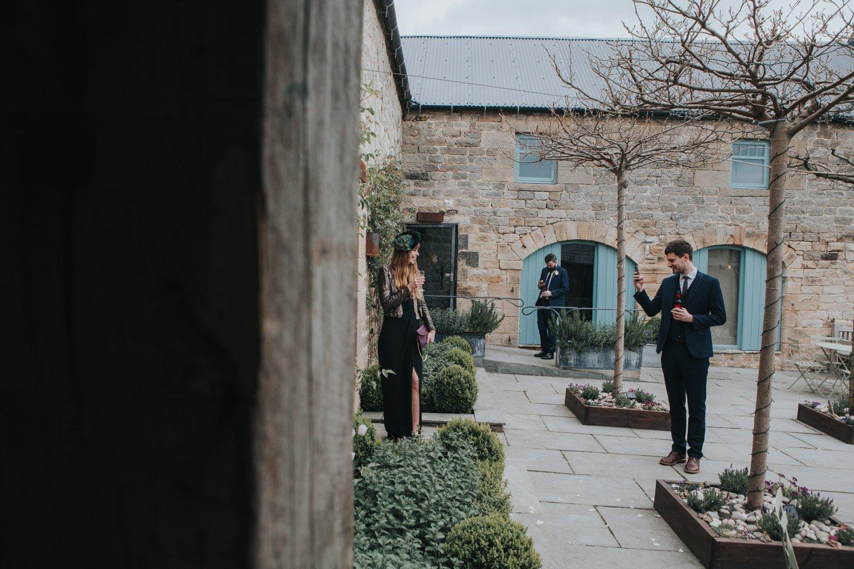 Healey Barn Wedding - Guests taking photos