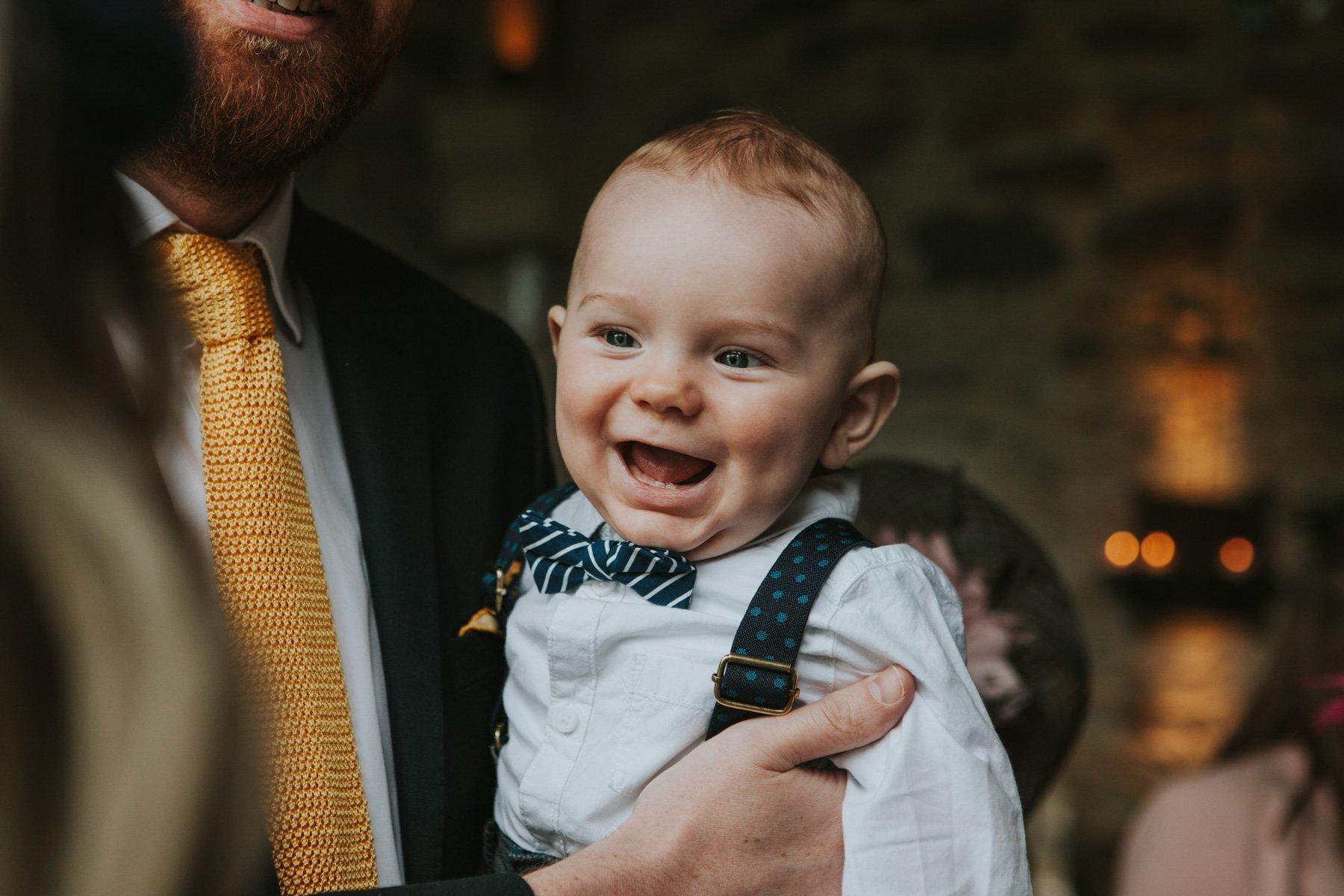 Healey Barn Wedding Photographer - baby guest smiling