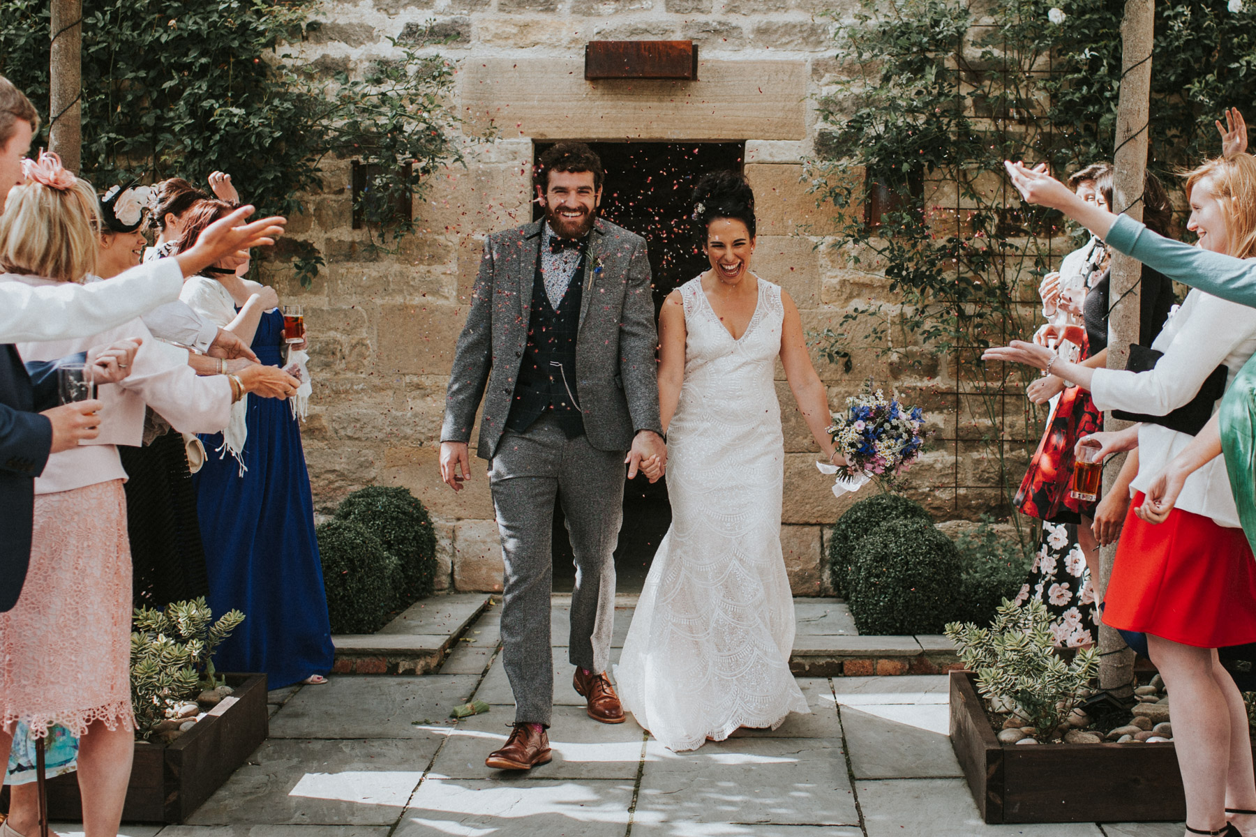 Healey Barn Wedding - Wedding Photographer Northumberland - bride and groom are cover in confetti