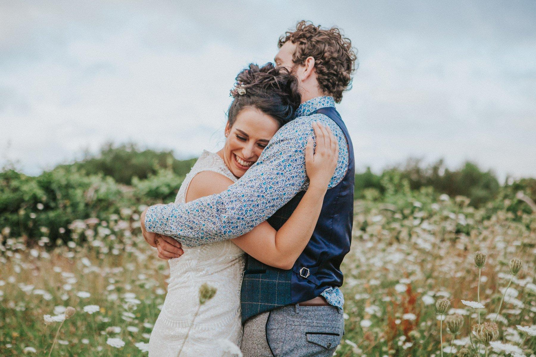 Healey Barn Wedding Photography - Couple portraits in wild flowers