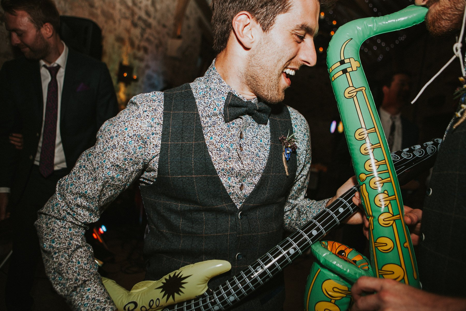 Healey Barn Wedding - Groomsmen Dances with inflatable instruments