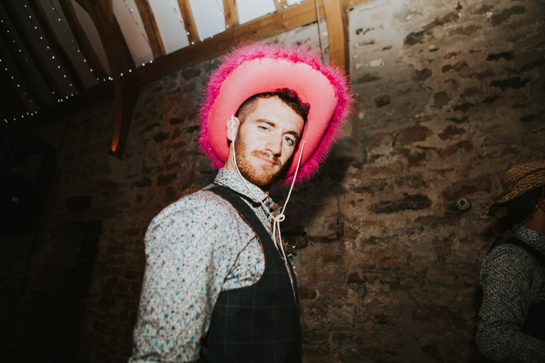 Healey Barn Wedding -Best man dancing with pink cowboy hat