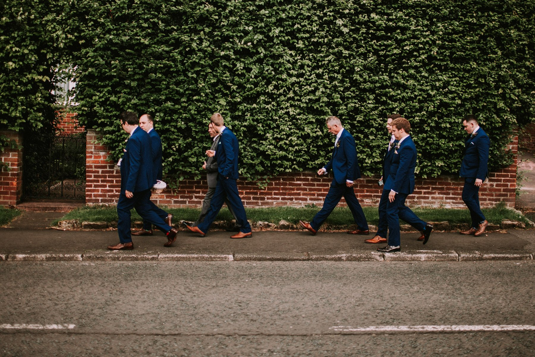 Summerhill bowling club wedding - groom and groomsmen walk down to the church
