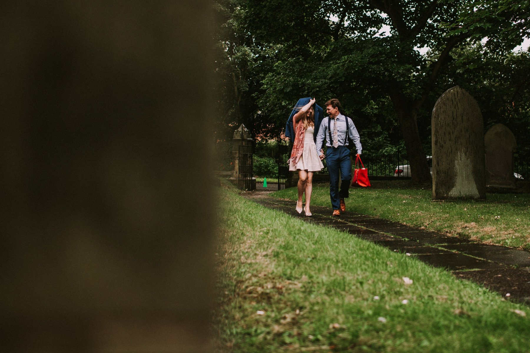 summerhill bowling club wedding - wedding guests running in the rain
