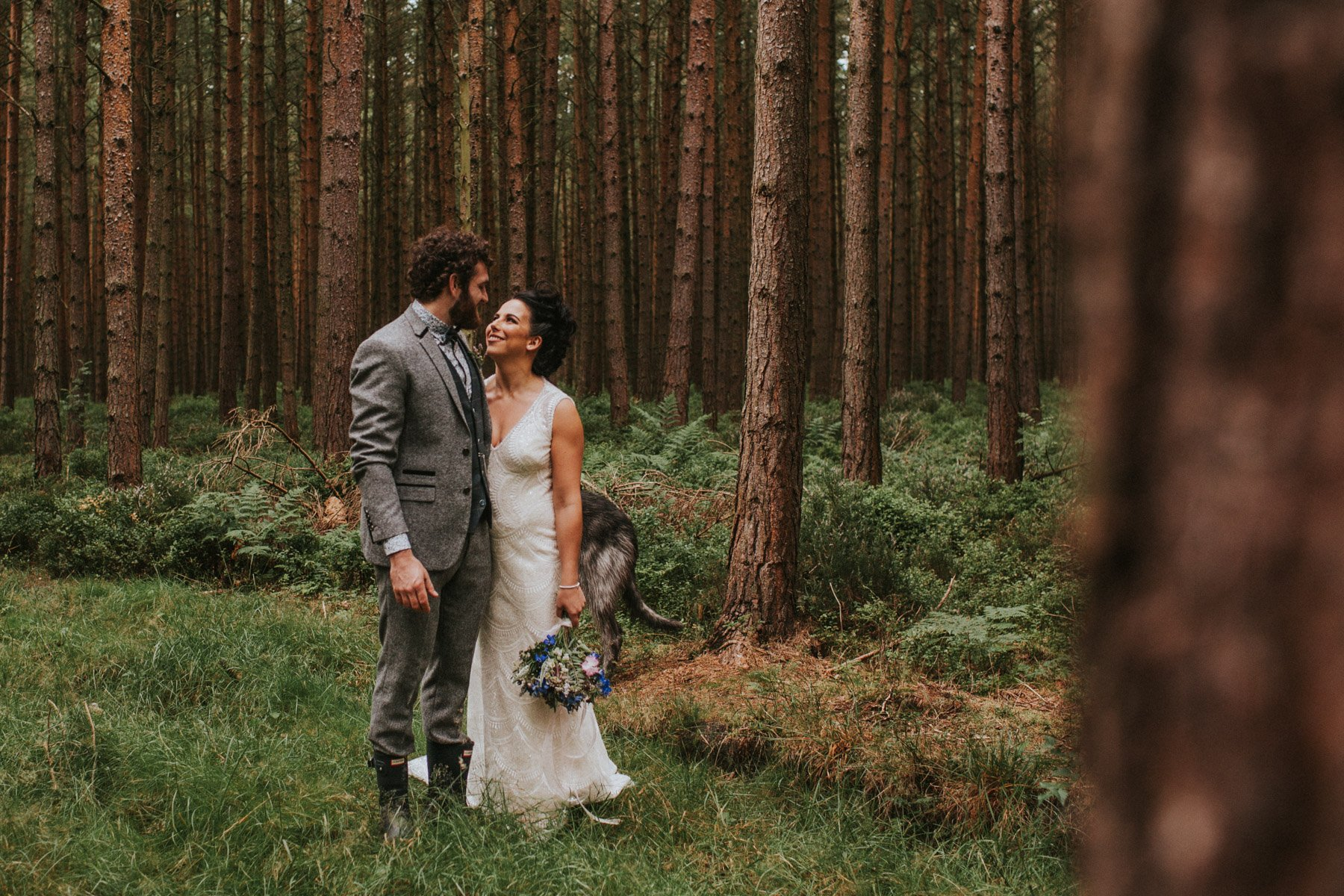 Healey Barn Wedding - Couple take a walk in the woods for portraits
