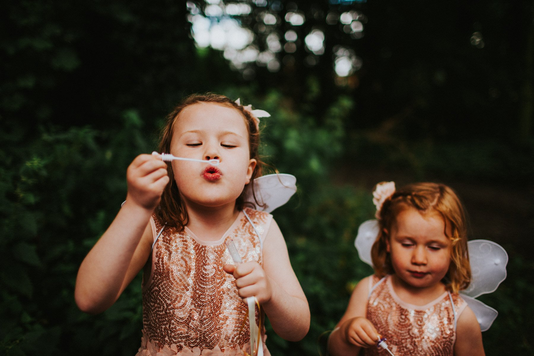 Newcastle Wedding Photographer - Flower Girls blow bubbles at Summerhill Bowling Club Wedding