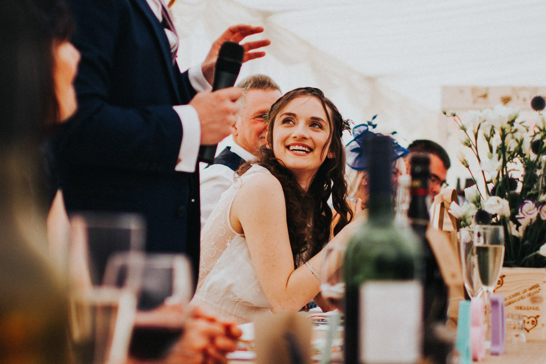 Summerhill bowling club marquee reception - bride laughs at grooms speech