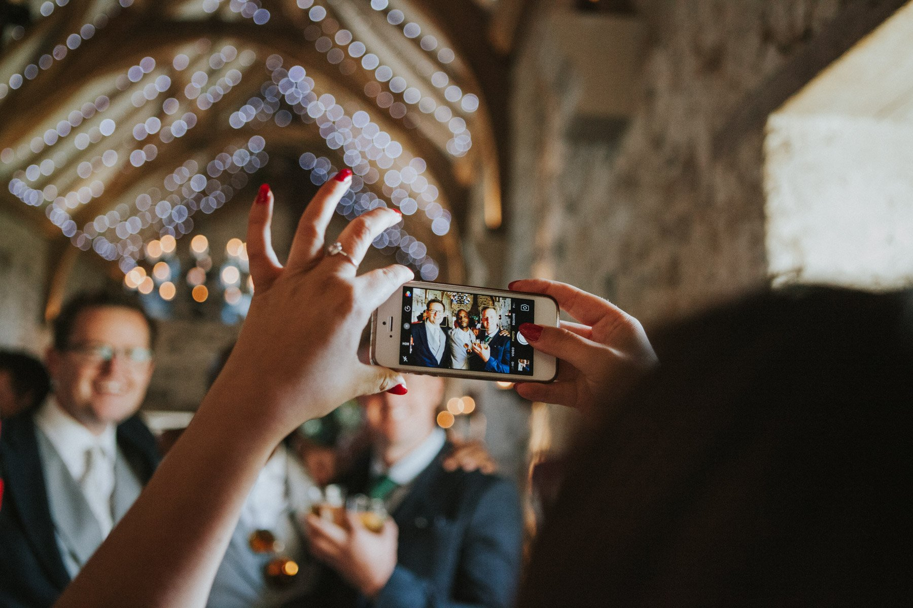 Healey Barn Wedding - Guest taking a photo