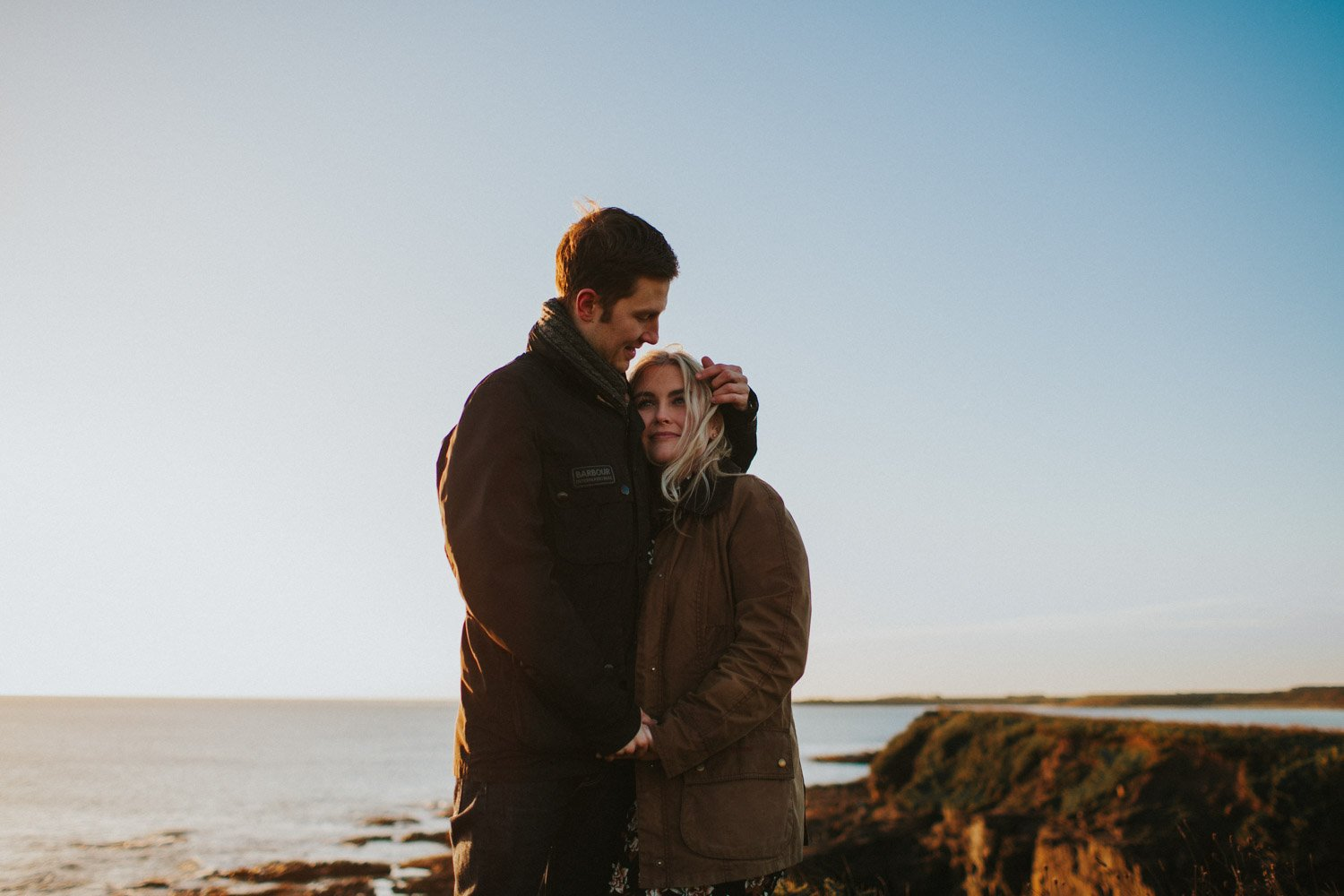 pre wedding session on top of beach cliffs - northumberland wedding photographer