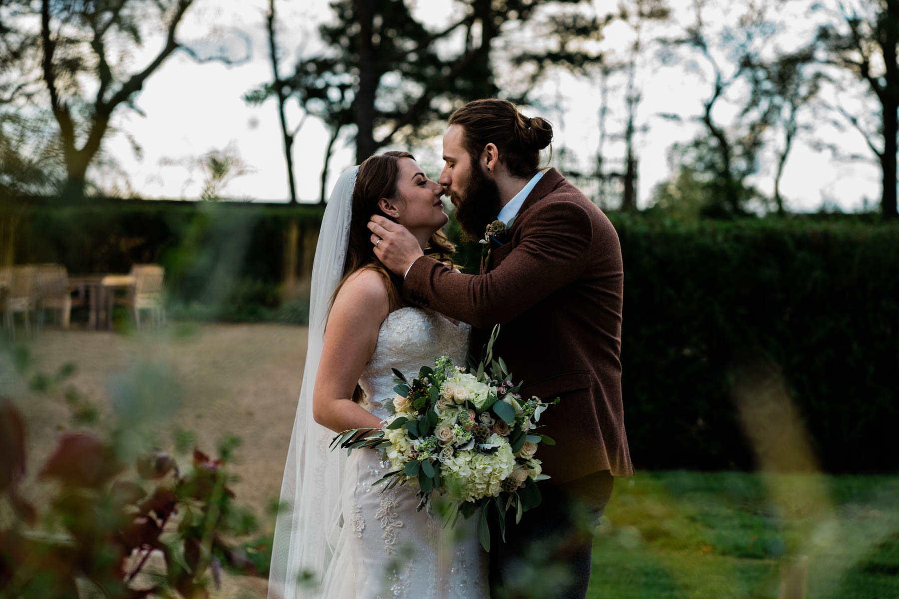 Newton Hall Wedding Photos - kissing in the grounds