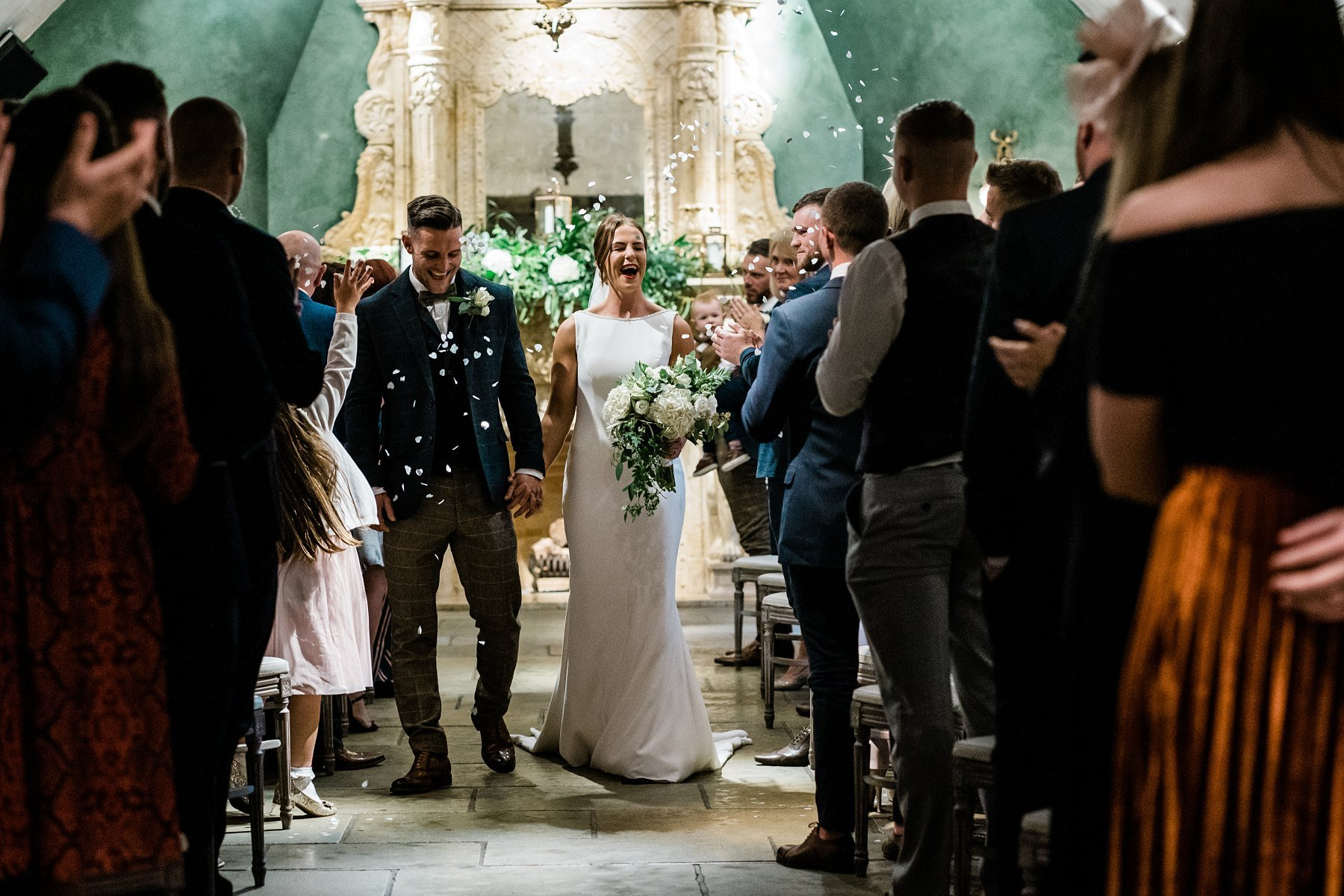 confetti walking up the aisle Le petite Chateau wedding - Newcastle Wedding Photographer