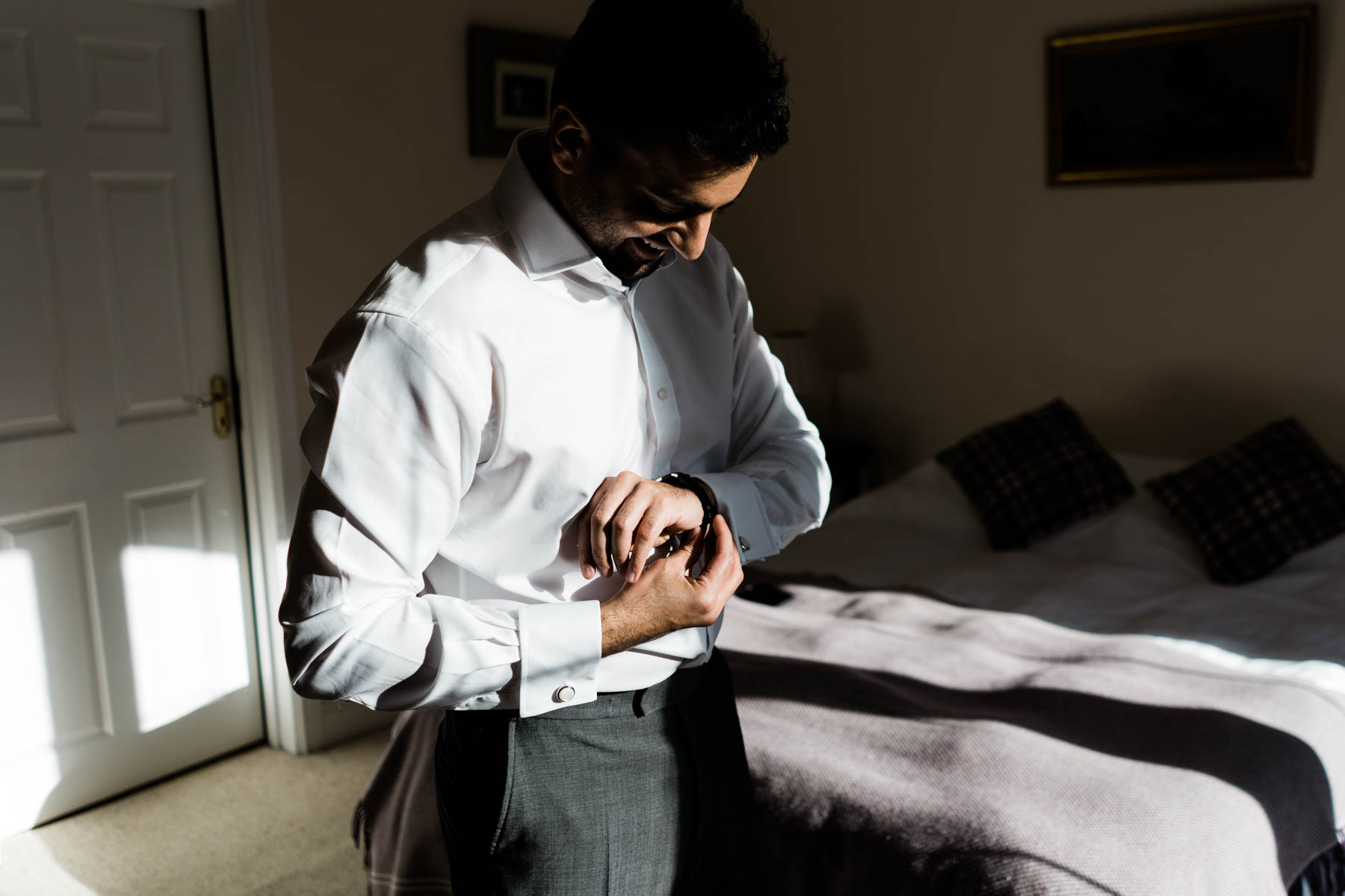 Eshott Hall Wedding Photographer | Groom putting on cuff links