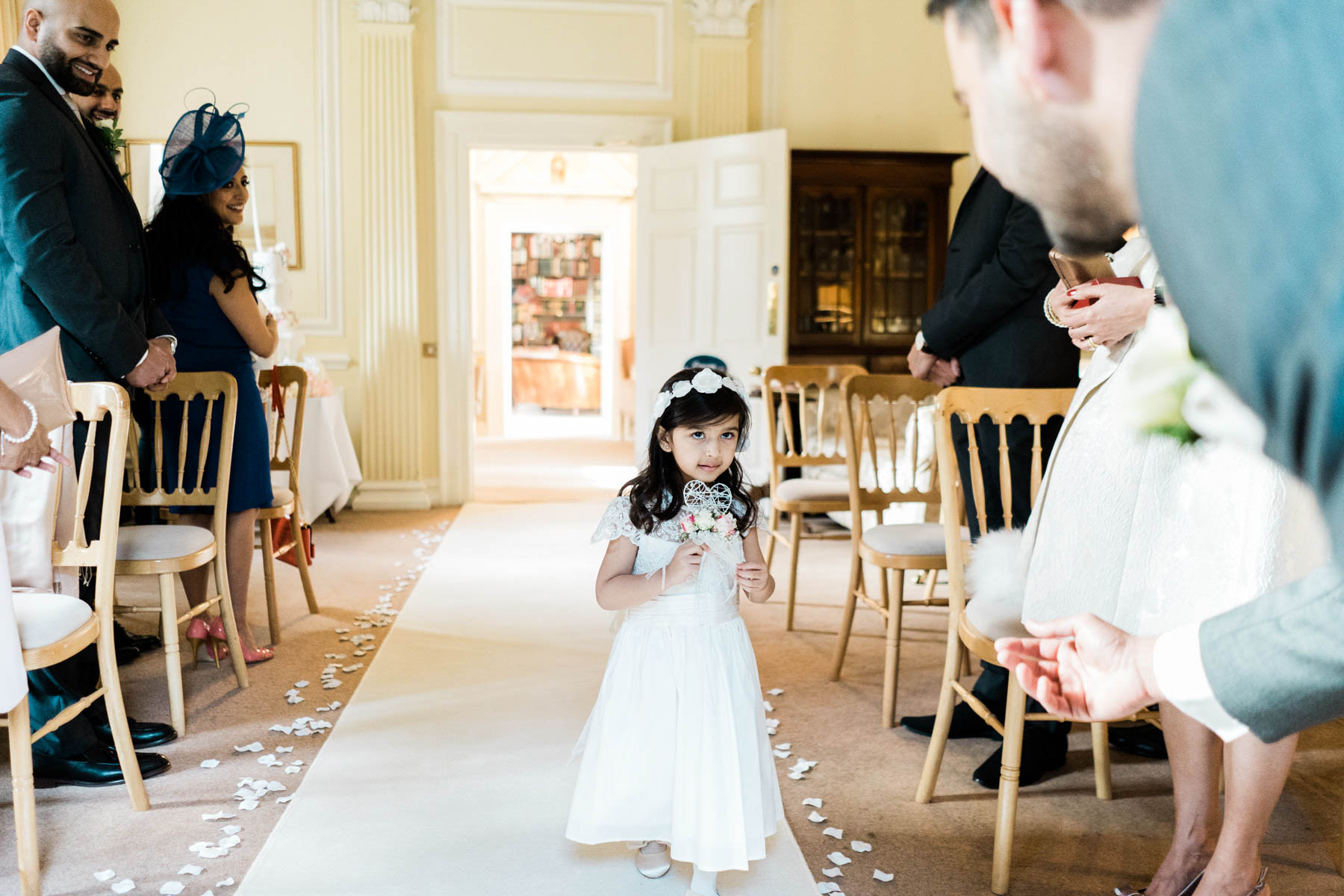 Eshott Hall Wedding Photographer | flower girl walks down aisle