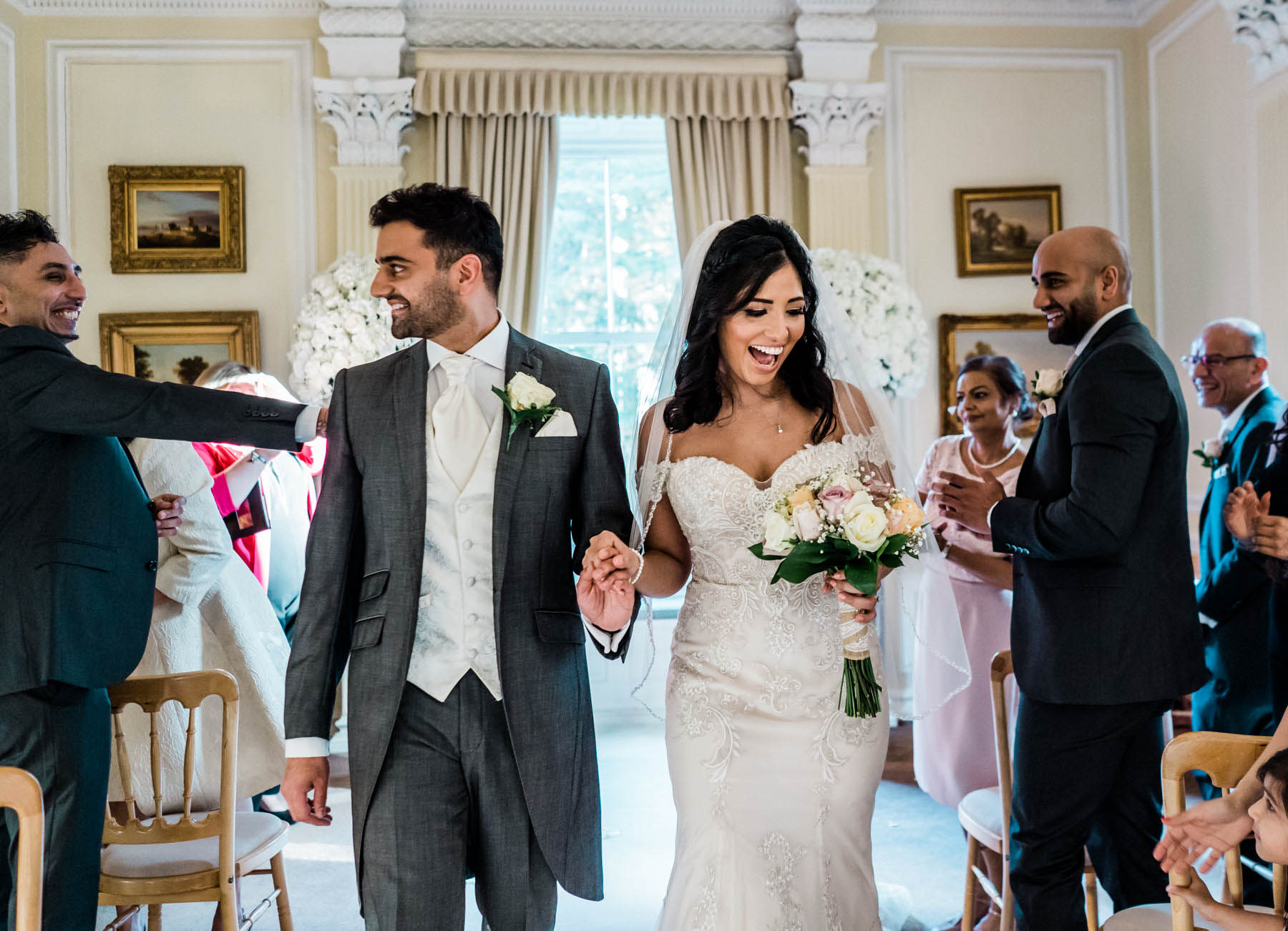 Eshott Hall Wedding Photographer | wedding ceremony exit