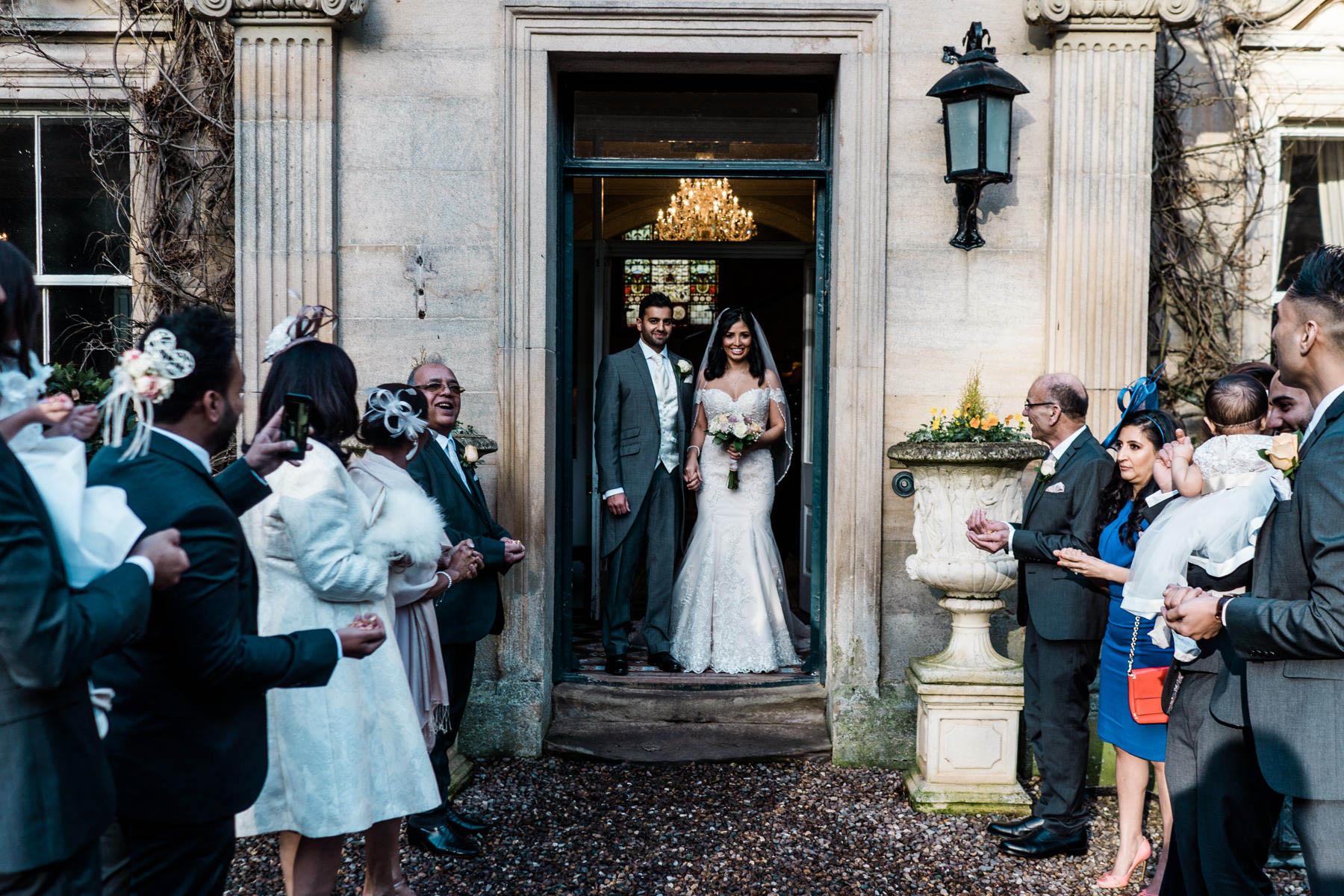 Eshott Hall Wedding Photographer   wedding ceremony confetti