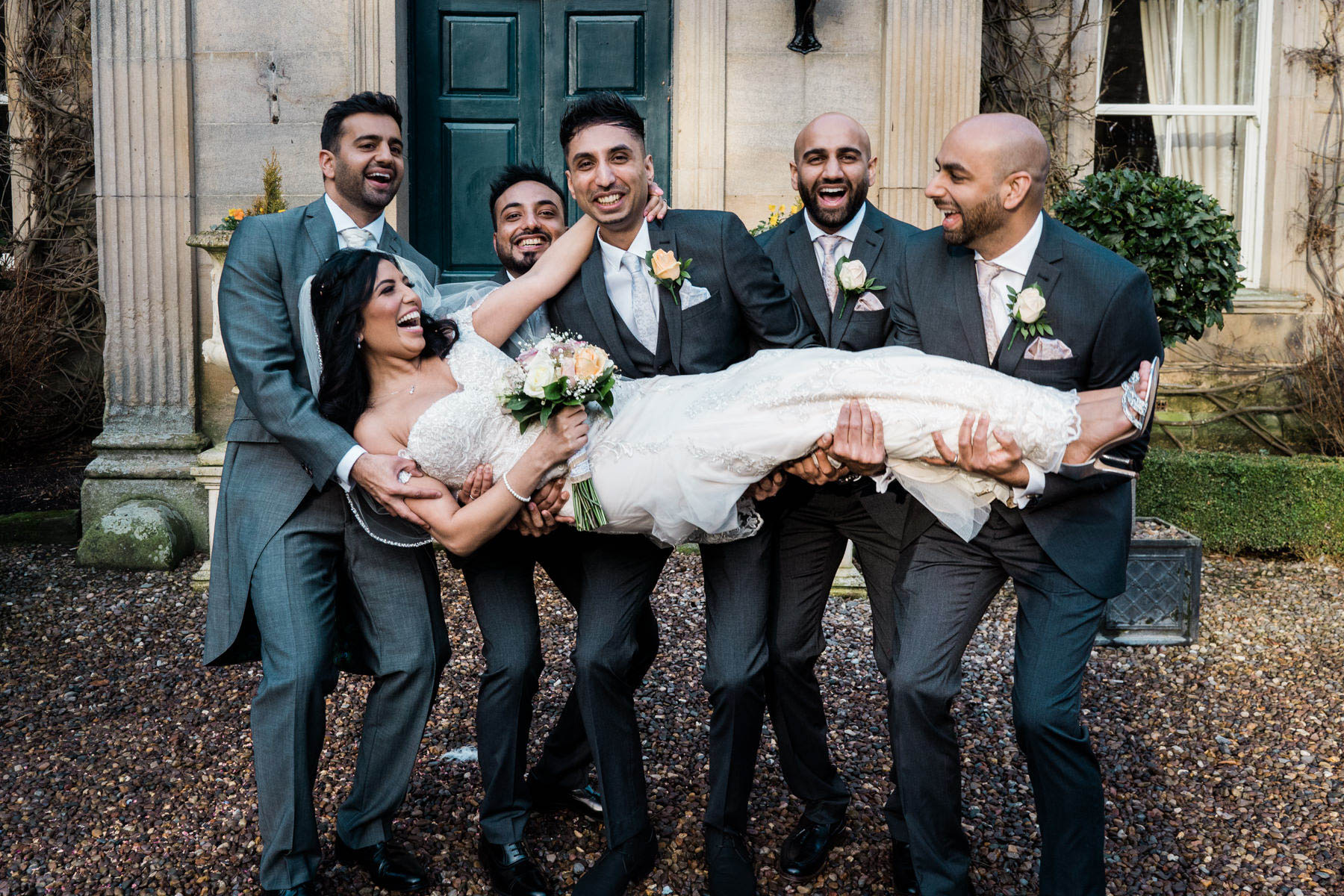 Eshott Hall Wedding Photographer | bride pick up by groomsmen
