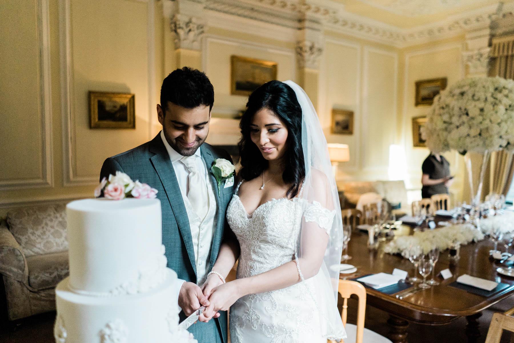 Eshott Hall Wedding Photographer   cake cutting