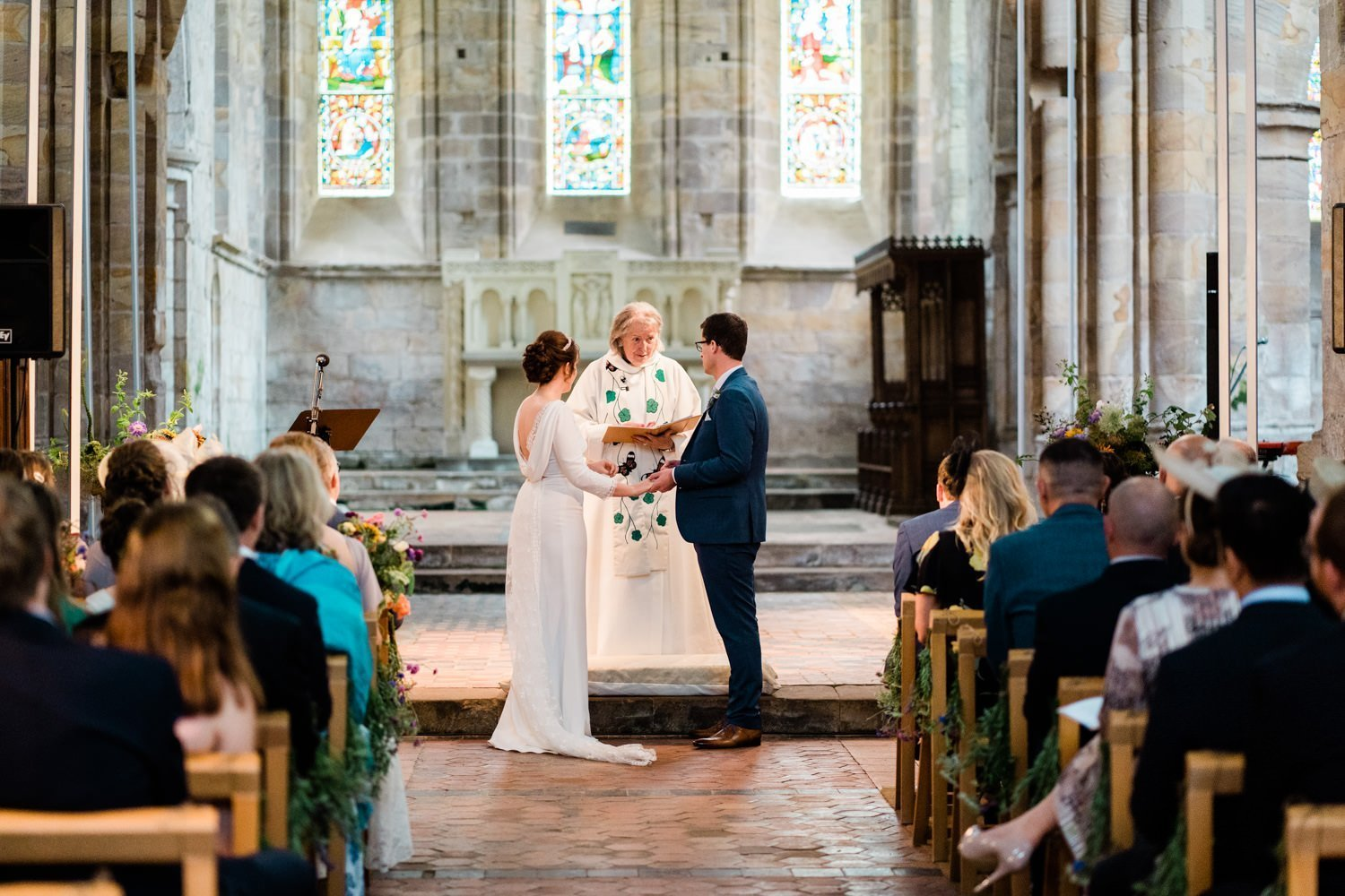 exchanging rings - london wedding photographer